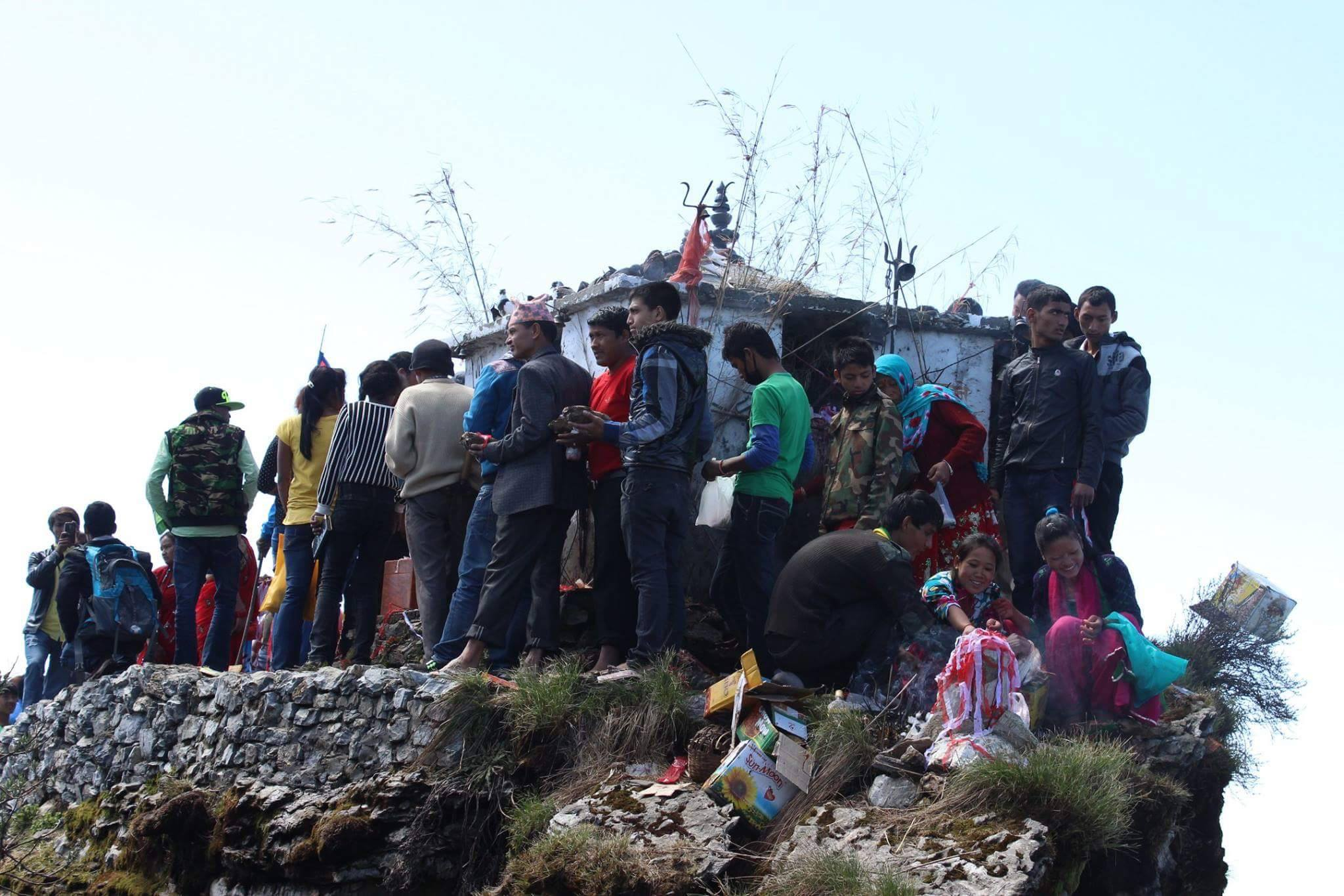 People waiting for their turn to worship the holy god at Ghumte temple, Galkot, Nepal